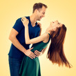 Leinwanddruck Bild - Portrait of young happy hugging couple