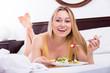 Leinwanddruck Bild - Woman in lingerie having a salad