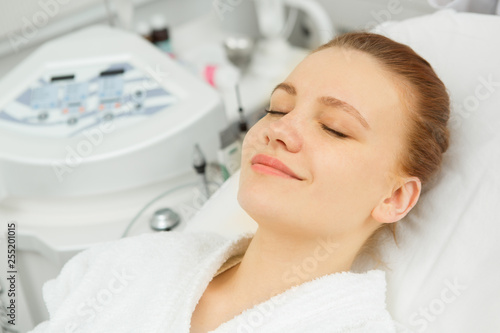 Leinwanddruck Bild Shot of a cheerful young woman smiling joyfully with her eyes closed waiting for facial treatments at spa salon happiness vitality wellbeing wellness lifestyle luxury skincare health beauty pampering