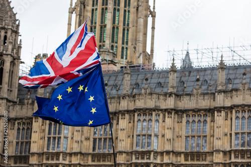 Leinwanddruck Bild European Union and British Union Jack flag flying together.