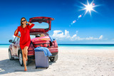 Slim young woman and red summer car on beach. Free space for your decoration.