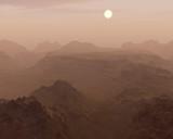Misty sunrise over rough mountain landscape.