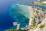 Beautiful aerial view of the coastline and the Adriatic sea, Omis town, Dalmatia region, Croatia