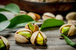 Pistachios with green leaves .