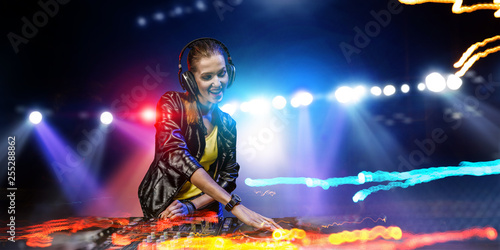 Female dj in nightclub. Mixed media - 255288862