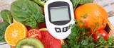 Glucometer for measuring and checking sugar level and fruits and vegetables. Concept of diabetes, healthy lifestyles and nutrition