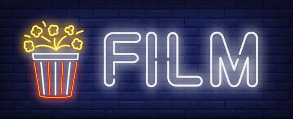 Film neon text with popcorn bucket