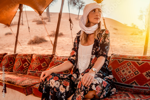 Travel woman in beduin village in the desert