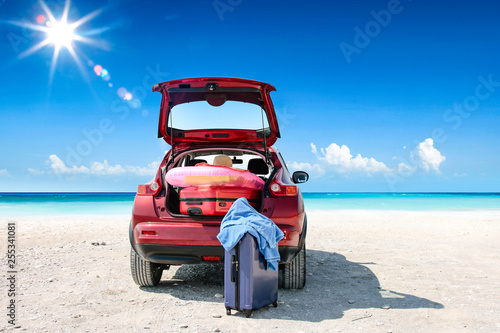 Leinwanddruck Bild Summer car on beach and sea landscape