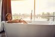 Leinwanddruck Bild - Relaxing in bath- beautiful woman in bath drink champagne .