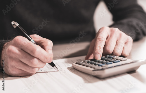 Hand using calculator, accounting concept
