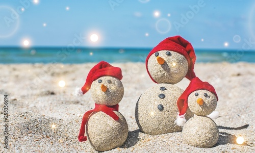 Sandy snowmen. Holiday concept can be used for New Year's and Christmas Card