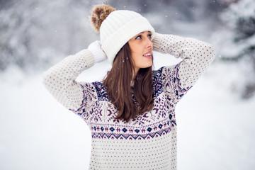 Winter portrait of pretty fashionable woman