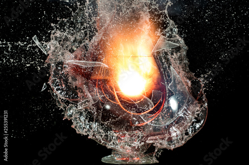 The explosion of a glass of wine on a black background, a lot of shards