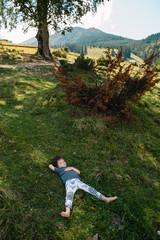 Little boy walking near of a mountain village © Serhii