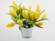 Bouquet of yellow tulips in bucket isolated on white