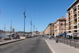 Marseille Old Port district with paved street and docks of the marina