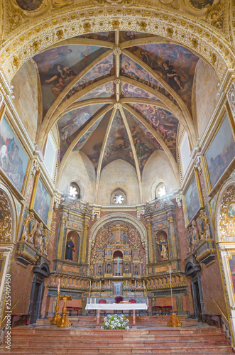 CORDOBA, SPAIN - MAY 26, 2015: The of presbytery in church Iglesia de San Augustin with the fresco of angels on the ceiling from 17. cent. by Cristobal Vela and Juan Luis Zambrano.