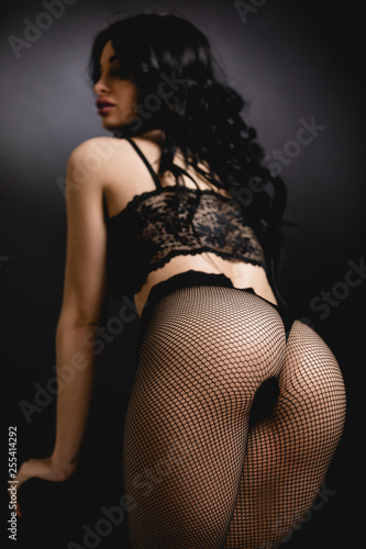obraz PCV Sexy butt woman in lace black sensual lingerie and pantyhose in studio. Luxury ass in stockings