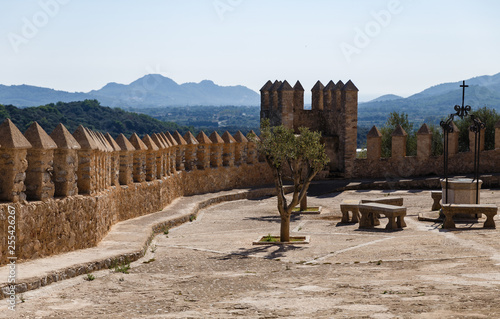 old town fortification wall with towers; View of the building from the mountains and the populated valley
