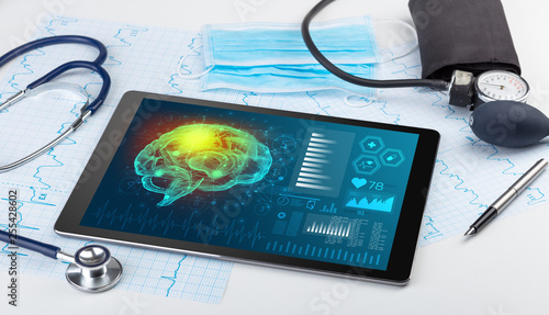 Leinwanddruck Bild Brain functionality report with medical devices around