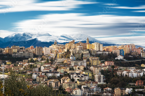 Chieti, one of the oldest cities in Abruzzo, with the snow-covered Maiella behind - 255449034
