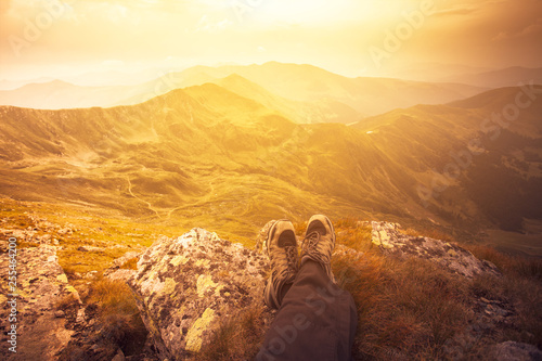 Mountain landscape first person view sitting on a rock admiring the view