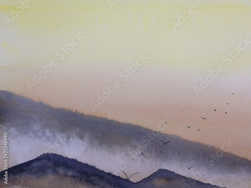 watercolor painting landscape sunset or sunrise  on the mountain fog with birds flying in the sky. © atichat