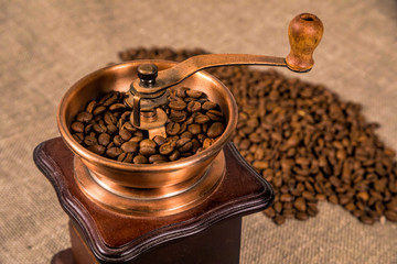 Coffe beans with coffe grinder