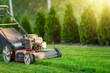 Leinwandbild Motiv Lawn mower cutting green grass