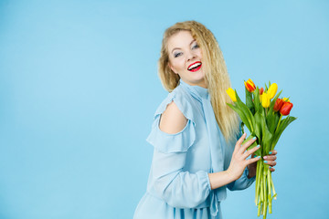 Pretty woman with red yellow tulips bunch