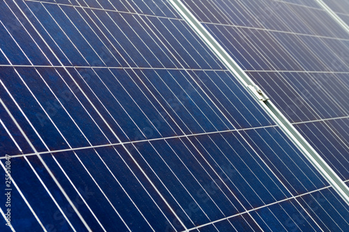 Closeup on solar cell photovoltaic panels at energy production plant