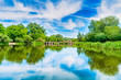 Leinwanddruck Bild - Calm landscape with blue river and green trees