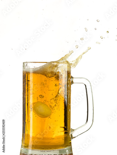 Pouring light beer in a beer mug, it turns out foam and spray