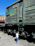 Little curious boy explore old cargo diesel locomotive