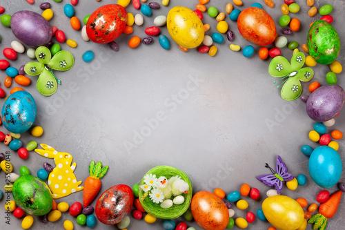 Leinwandbild Motiv Colorful Easter eggs,chocolate Easter sweets and bunny