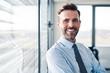 Leinwanddruck Bild - Portrait of successful businessman in modern office