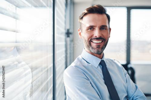 Leinwanddruck Bild Portrait of successful businessman in modern office