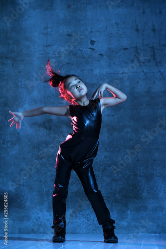 High Fashion asian model girl in colorful bright neon uv blue and purple lights looks up - 255624805