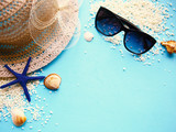 Straw hat, sunglasses and starfish on blue background. Summer holiday abstract background - 255629247
