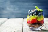 Fototapeta Tęcza - rainbow fruit granola and Greek yogurt parfait © nata_vkusidey