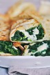 Pancakes with spinach and cheese - 255637224
