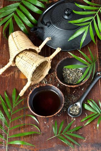 Tea ceremony, green tea, tea pot and tea cups © amberto4ka