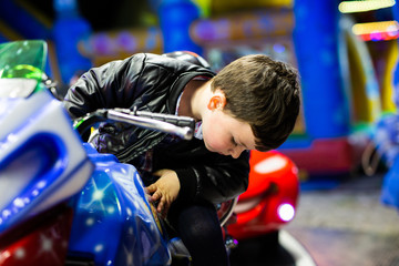 boy at the fair on a motorcycle