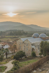 Isa Bey Mosque by hills at sunset, in Selçuk, Turkey © Mark Zhu