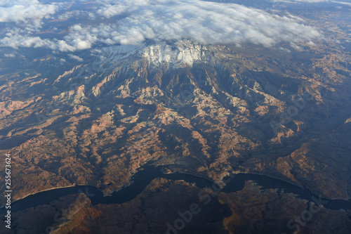 Aerial View of Snow Covered Mountain  and River - 255673624