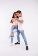 Leinwandbild Motiv Passionate couple dancing social danse kizomba or bachata or semba or taraxia on white background