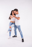 Passionate couple dancing social danse kizomba or bachata or semba or taraxia on white background