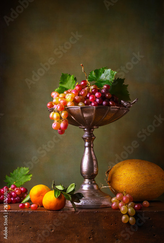 Still life with grapes, tangerines and melon © Marta Teron