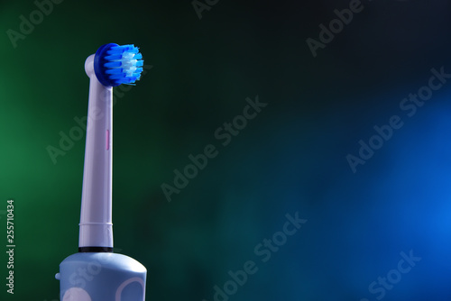 Leinwanddruck Bild Modern electric toothbrush powered by rechargeable battery